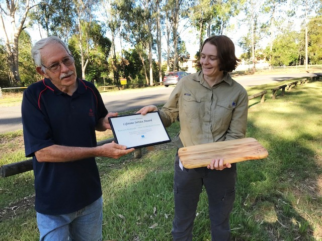 Anna Sheera presenting certificate to Bruce Turner