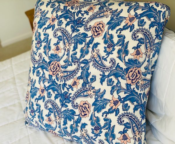 Spell Etienne blue and peach wrapped around a large cushion